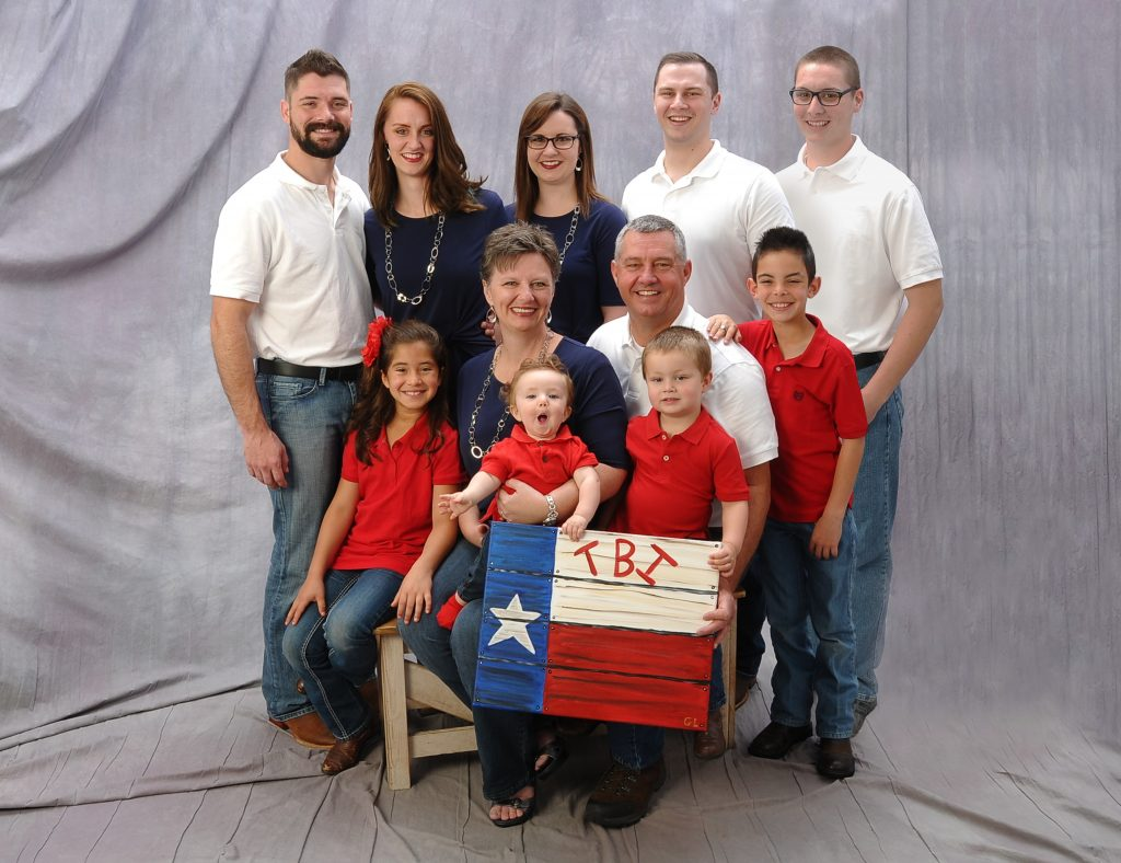 Gordon Law Family Picture with TBI sign board